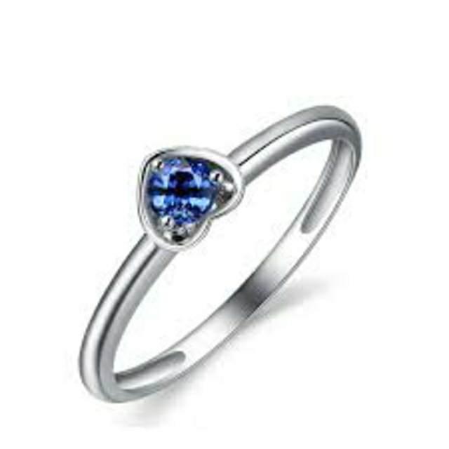 anillo de compromiso diamante azul elegante
