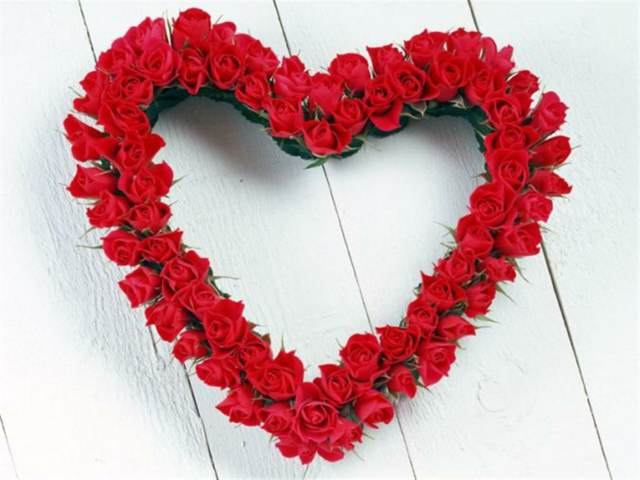 feliz San Valentín flores forma corazón