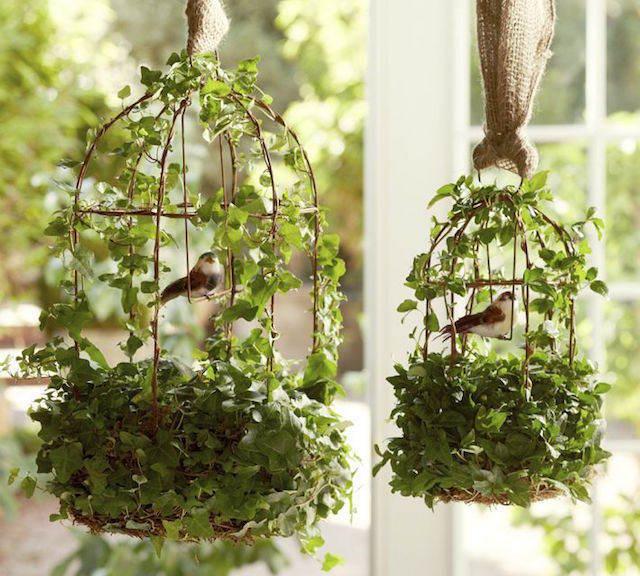 jaula de pájaros decoración hojas artificiales como naturales